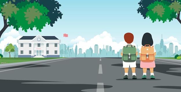 Os alunos carregam sacolas caminhando a caminho da escola.