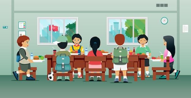 Os alunos estão almoçando no refeitório da escola