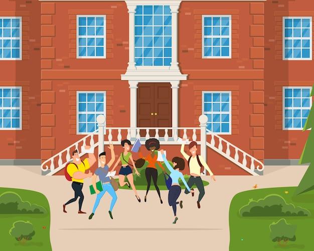 Os alunos pulam e se alegram no pátio da faculdade.