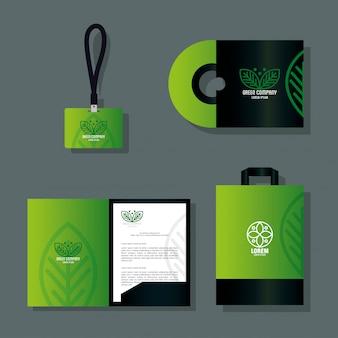 Os artigos de papelaria de maquete fornecem cor verde, identidade verde corporativa