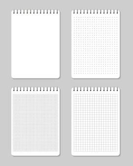 Os cadernos alinharam e pontilham o vazio da página do papel.