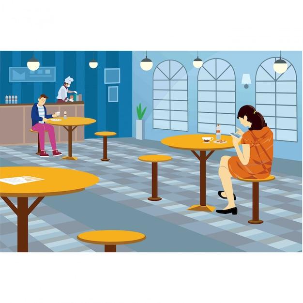 Os clientes estão mantendo distância enquanto comem no restaurante