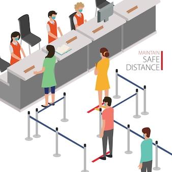 Os clientes mantêm distância enquanto alinham na fila da caixa do banco