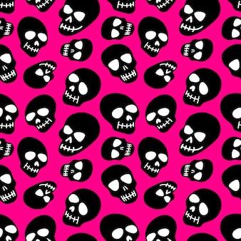 Os crânios com o padrão do crânio em um fundo preto