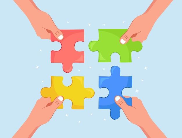 Os empresários seguram nas mãos as peças do quebra-cabeça e conectam-nas.