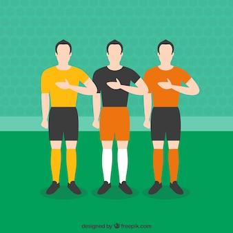 Os jogadores de futebol que escutam o hino