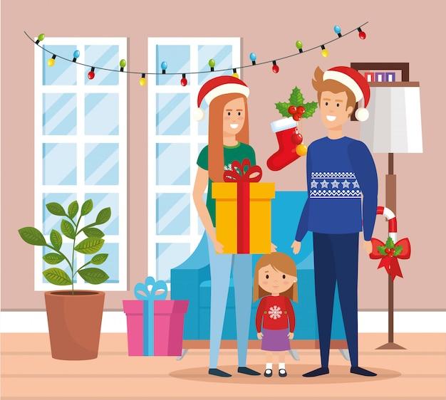Os pais casal e filha com roupas de dezembro na sala de visitas