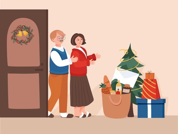 Os pais receberam presentes das crianças com árvore de presentes pacote de alimentos nas férias de inverno