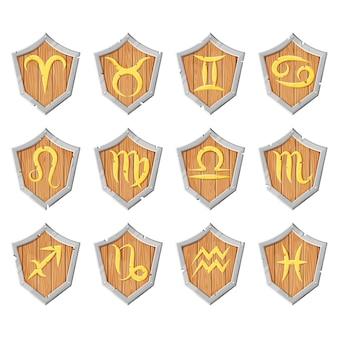 Os signos dourados do zodíaco são dispostos em placas de madeira com facetas de metal