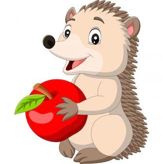 Ouriço de bebê dos desenhos animados, segurando a maçã vermelha