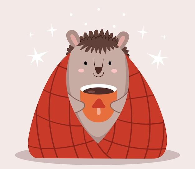 Ouriço fofo em uma manta bebe cacau. outono escandinavo. foto infantil.