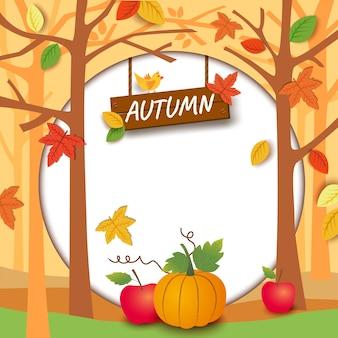 Outono com abóbora e maçã com círculo no fundo da folha e da árvore.