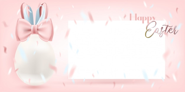 Ovo branco de easter com o cartão de bunny bow e do blanc no fundo cor-de-rosa. modelo para saudação calorosa