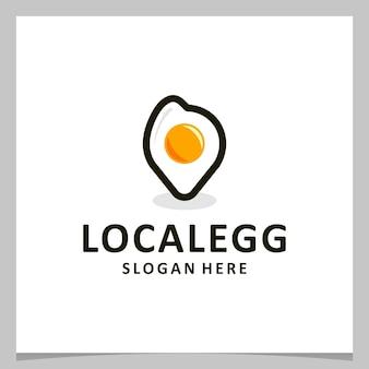 Ovo de design de logotipo de inspiração com logotipo de localização. vetor premium