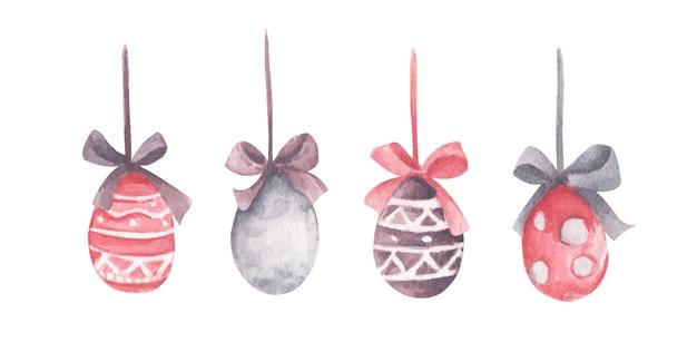 Ovos de páscoa coloridos em aquarela pendurados em fitas