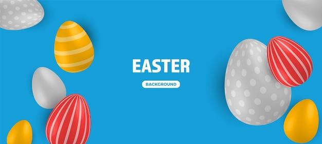 Ovos de páscoa coloridos sobre fundo azul.