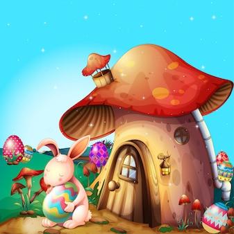 Ovos de páscoa escondidos perto de uma casa projetada por cogumelos