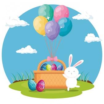 Ovos de páscoa na cesta de vime com coelho e balões de hélio
