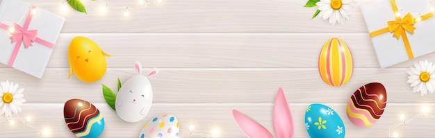 Ovos de páscoa, orelhas de coelho e caixas de presente