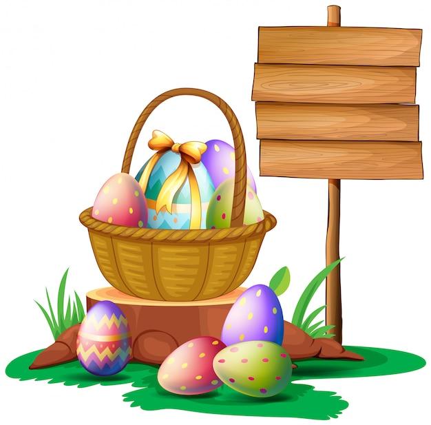 Ovos de páscoa perto de uma tabuleta de madeira