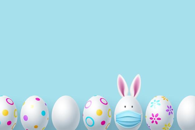 Ovos de páscoa pintados com orelhas e máscara de coelho. coronavirus, conceito de férias de proteção covid-19.
