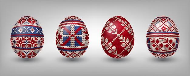 Ovos pascais decorados com padrões de tricô vermelho