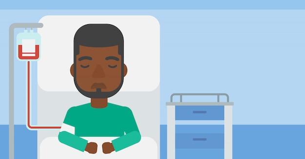 Paciente deitado na cama do hospital.
