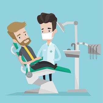 Paciente e médico no consultório do dentista.