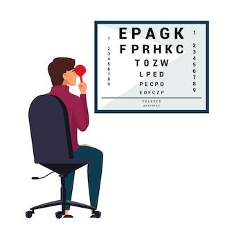 Paciente verifica a visão no teste óptico do olho no consultório do oftalmologista