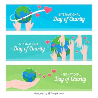 Pacote de bandeiras de mão e mundo do dia da caridade