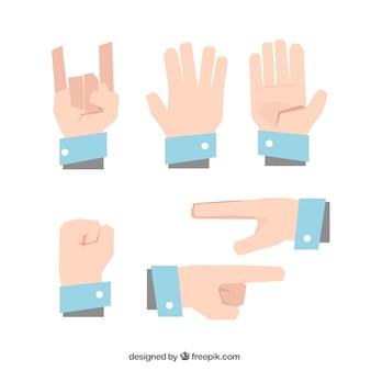 Pacote de mãos com gestos em design plano