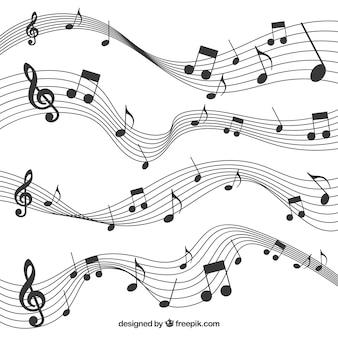 Pacote de pentagramas com notas musicais pretas