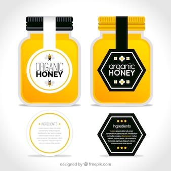 Pacote de potes de mel orgânicos com rótulos