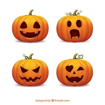 Pacote de quatro abóboras de halloween com caras engraçadas