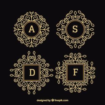 Pacote de quatro monogramas ornamentais de ouro