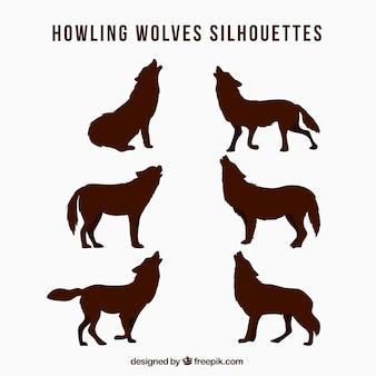 Pacote de silhuetas de lobo uivando