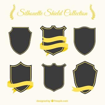 Pacote de silhuetas escudo com fitas douradas
