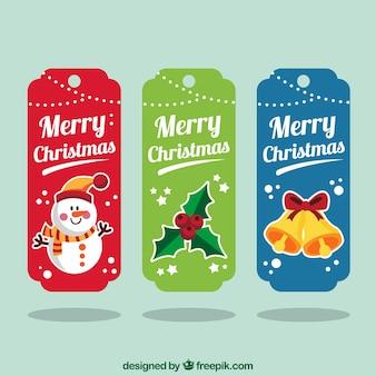 Pacote de três etiquetas coloridas do natal com elementos decorativos