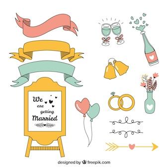 Pacote desenhado à mão de elementos do casamento