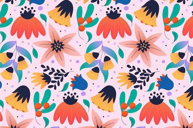 Padrão com flores tropicais coloridas e folhas
