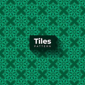 Padrão de azulejos verdes com formas ornamentais