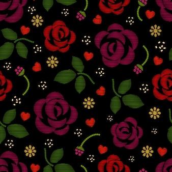 Padrão de bordado com flores rosas.