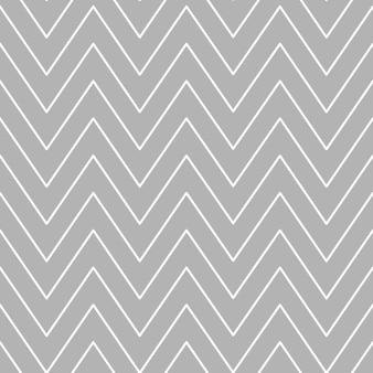 Padrão de chevron de natal abstrato com listras brancas em zigue-zague em um vetor de fundo cinza.