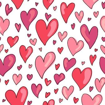 Padrão de corações desenhados mão sem emenda