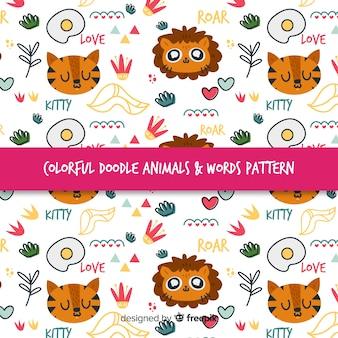 Padrão de felinos e palavras coloridas doodle