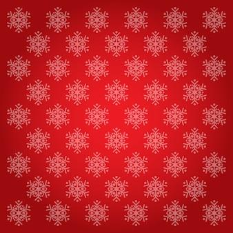 Padrão de flocos de neve e fundos vermelhos