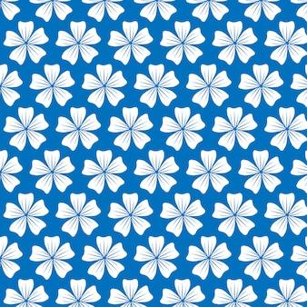 Padrão de flores sobre fundo azul