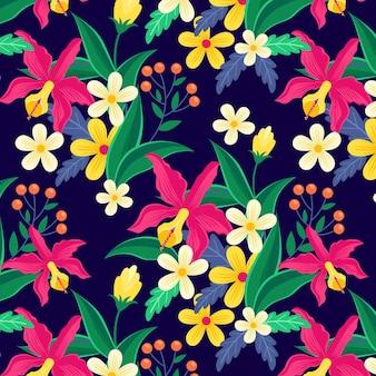 Padrão de folhas e flores exóticas coloridas