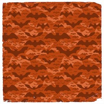 Padrão de halloween grunge com pipistrelles voadores escuros em plano de fundo vermelho