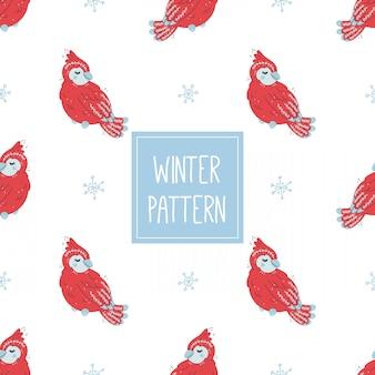Padrão de inverno com cardeal vermelho e flocos de neve
